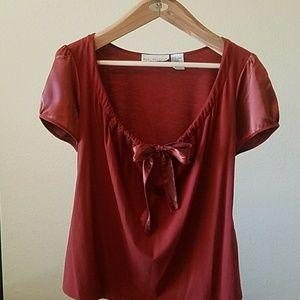 Fancy t shirt color is a dark rust